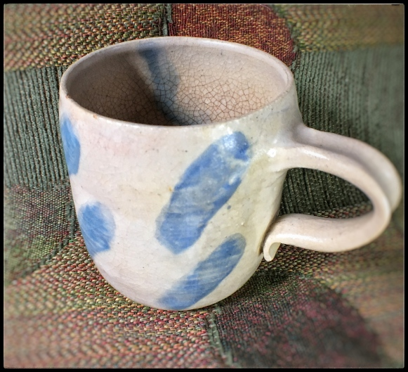 One of my oldest hand-thrown mugs. Notice the cracked inside glaze, stained by tea over 30+ years